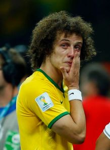 Brazil's Luiz cries after his team lost to Germany in their 2014 World Cup semi-finals at the Mineirao stadium in Belo Horizonte